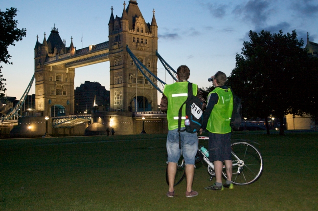 Cyclists in front of Tower Bridge
