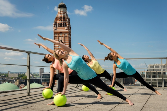 Tennis Yoga photographed by Karen Yeomans, specialist in Sports, Fitness, Health, Well-being and Yoga Photography. Based in London.